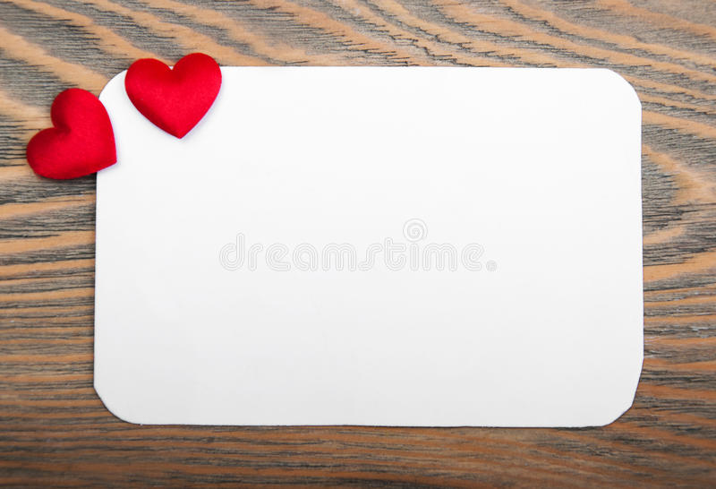 Blank valentines card. With red hearts on a wooden background stock photography