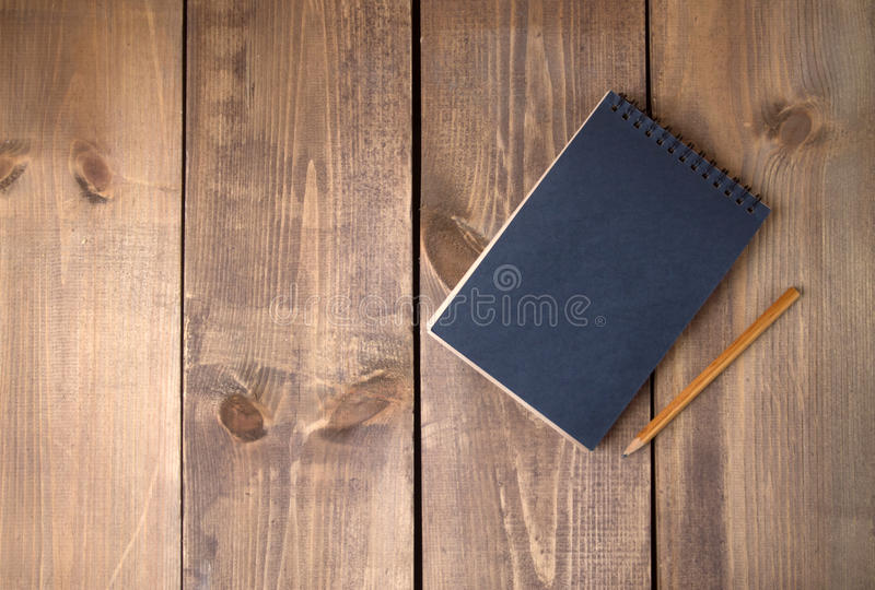 Blank vintage black paper notebook with pencil royalty free stock image