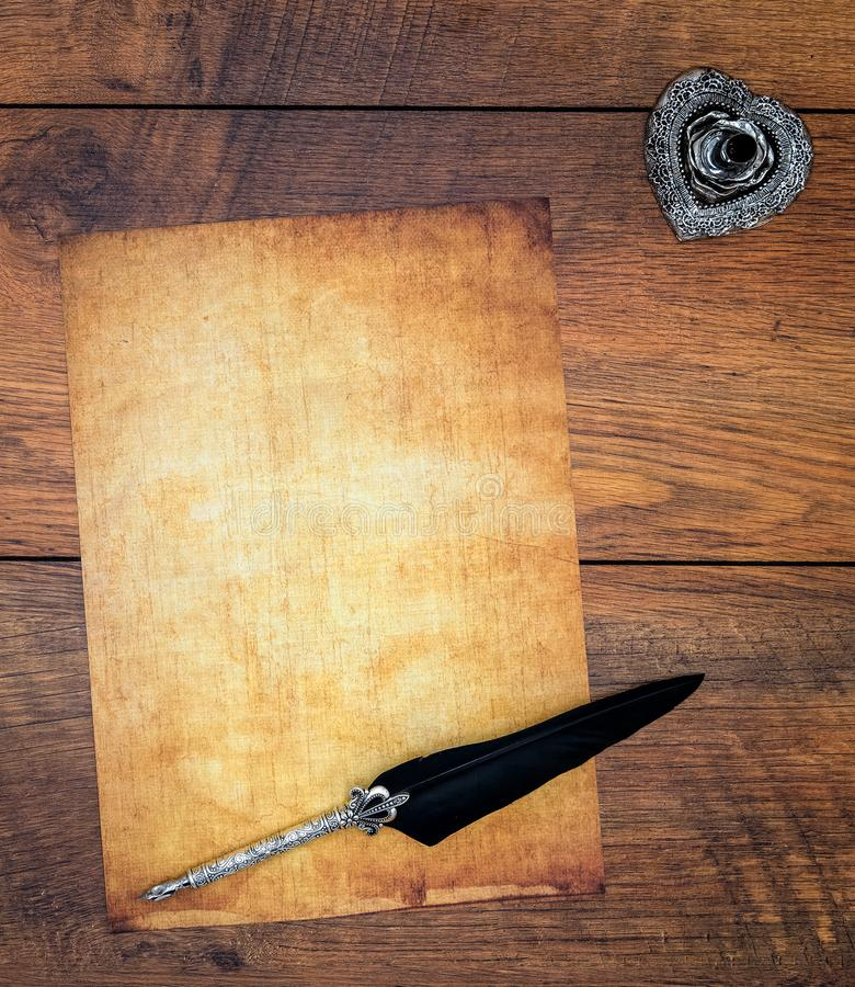 Blank vintage card with ink and quill on vintage oak - top view royalty free stock image