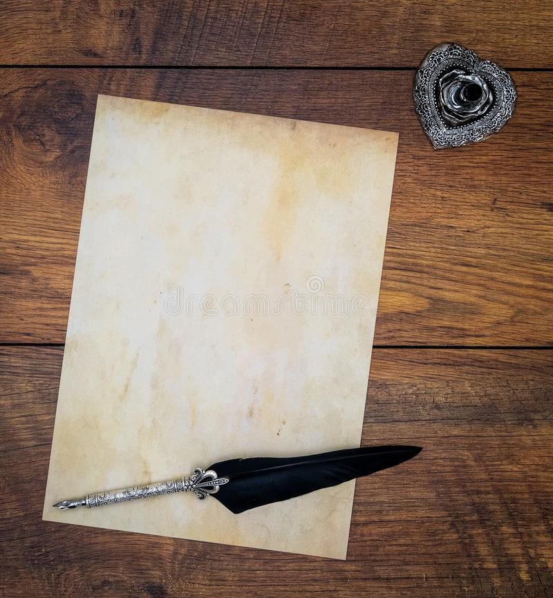 Blank vintage card with ink and quill on vintage oak - top view stock photos
