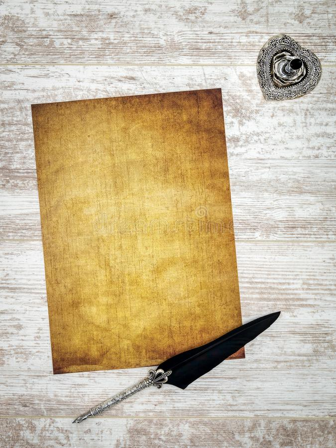 Blank vintage card with ink and quill on white painted oak - top view stock images
