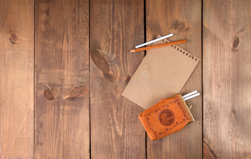 Blank vintage paper sheet and cigarettes with pen royalty free stock photos