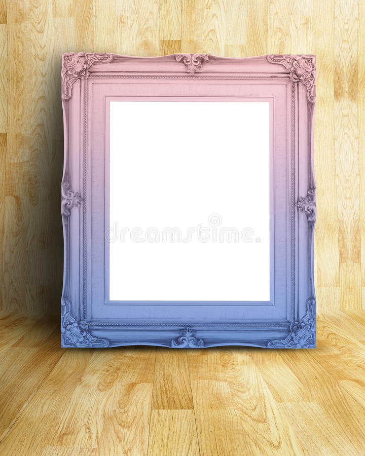 Blank Vintage pink and blue gradient Victorian style picture frame on parquet room,Mock up template for adding your content.  royalty free stock photography