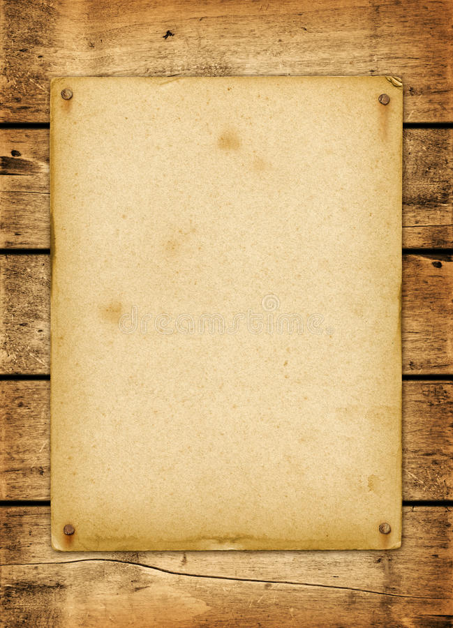 Blank vintage poster nailed on a wood board. Panel stock photography
