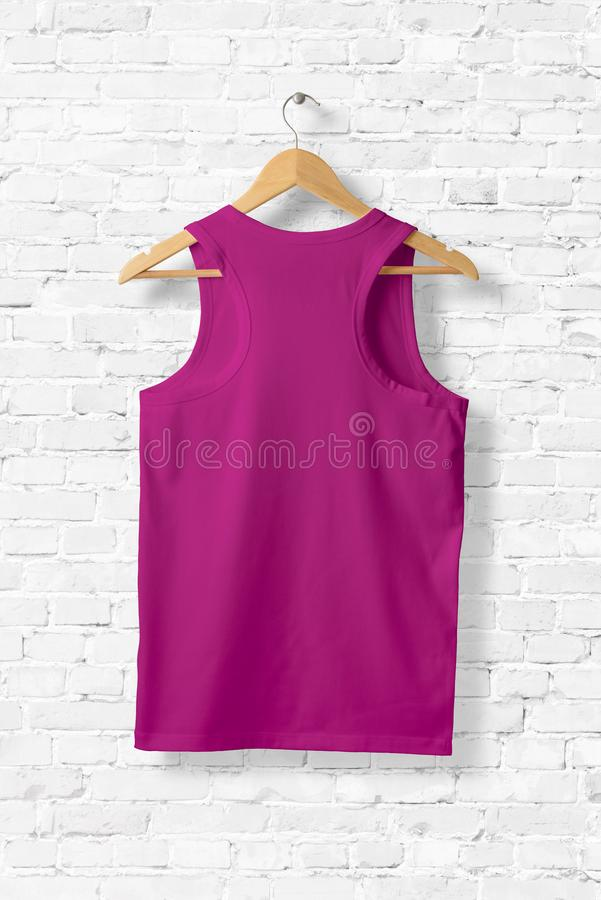 Blank Violet Tank Top Mock-up hanging on white wall. royalty free illustration