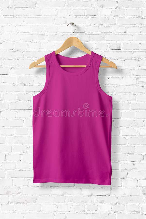 Blank Violet Tank Top Mock-up hanging on white wall. stock illustration