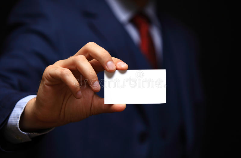 Blank visiting card in businessman hand royalty free stock photography
