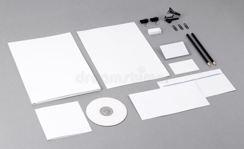 Blank visual identity. Letterhead, business cards, envelopes, folder, CD, pencil, eraser, clip. royalty free stock photo