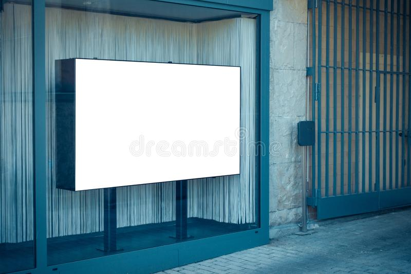 Blank white banner in showcase on the street, mock up royalty free stock photos