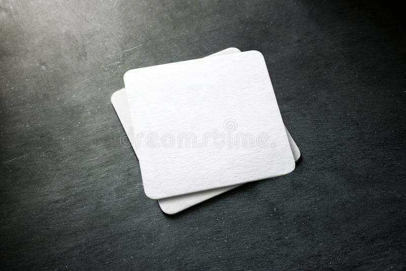 Blank white beer coaster stack mockup, top view royalty free stock photo