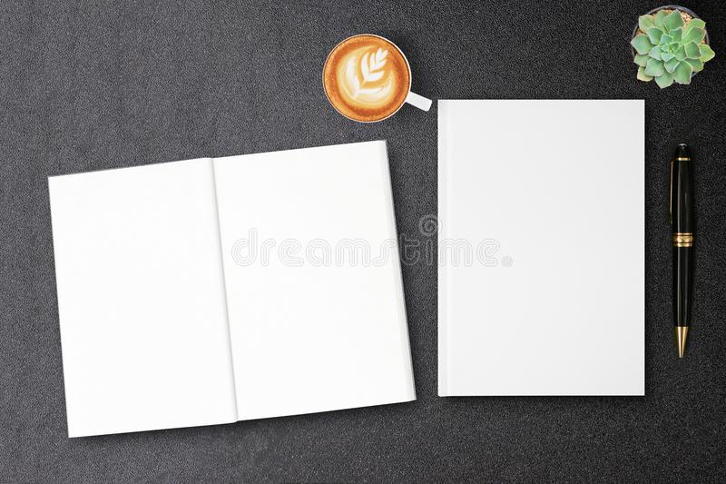 Blank hardcover canvas book mock up for design book cover on black table. Blank white book mockup and blank open magazine for design book cover on black table stock photography