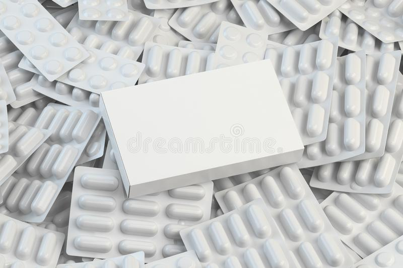 Blank white box for  pills on the pile of white blisters of pills and capsules. Medical mockup royalty free stock photo