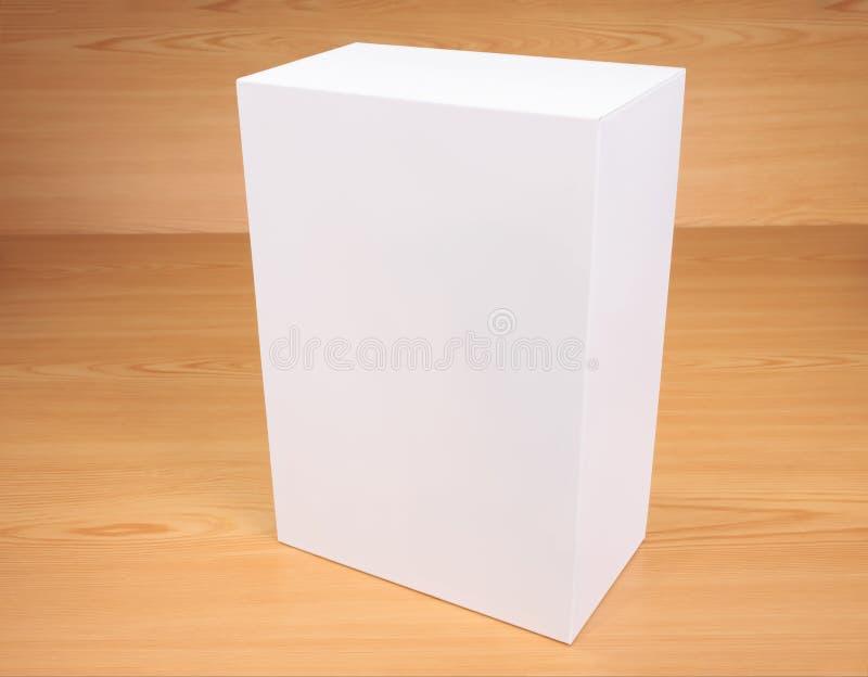 Blank white box on wood background royalty free stock photos