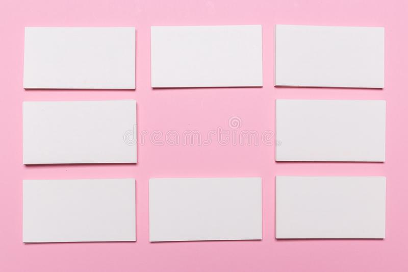 Blank white business cards on pink background stock photo