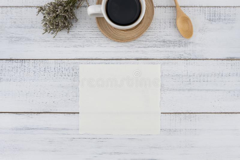 Blank white card and a cup of coffee with caspia bouquet stock photos