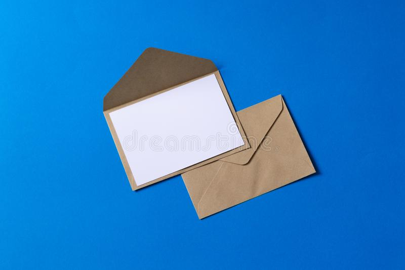 Blank white card with kraft brown paper envelope template mock up royalty free stock photos