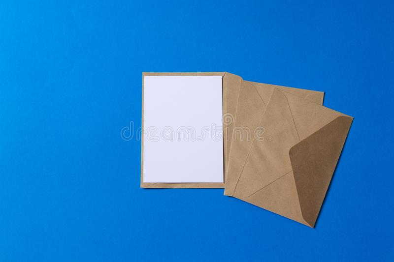 Blank white card with kraft brown paper envelope template mock up royalty free stock images