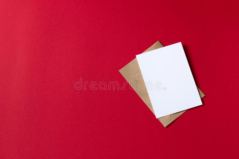 Blank white card with kraft brown paper envelope template mock up stock photography