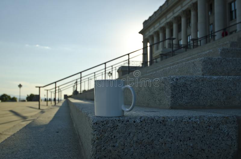 A blank white coffee mug on the corner of the capitol steps royalty free stock photo
