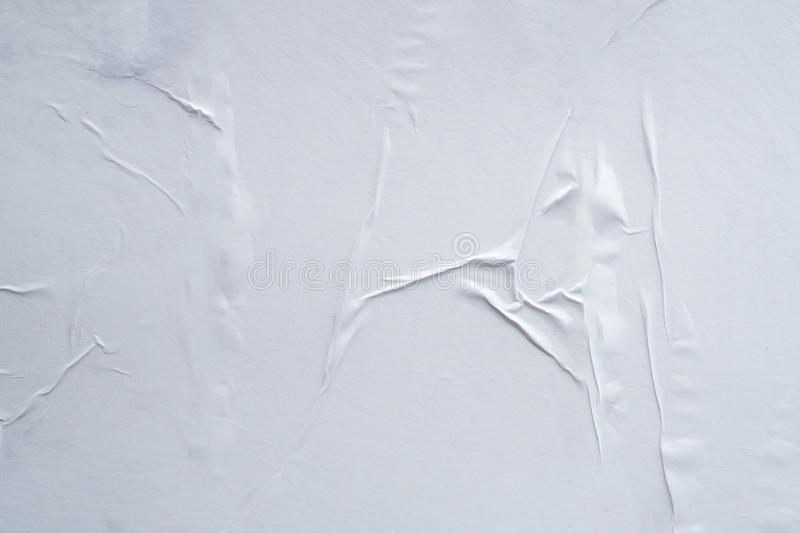 Blank white crumpled and creased paper poster texture background royalty free stock images