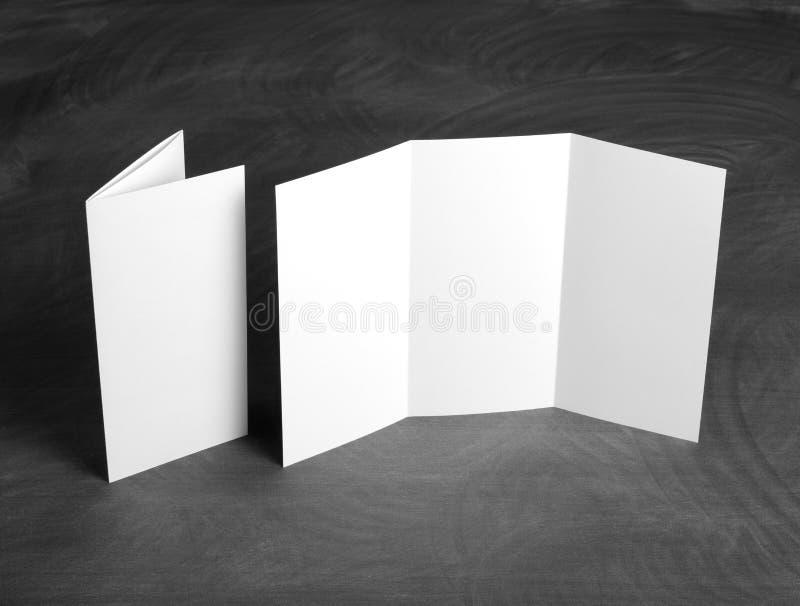 Blank White Folding Paper Flyer On A Black Chalkboard Stock Photo ...