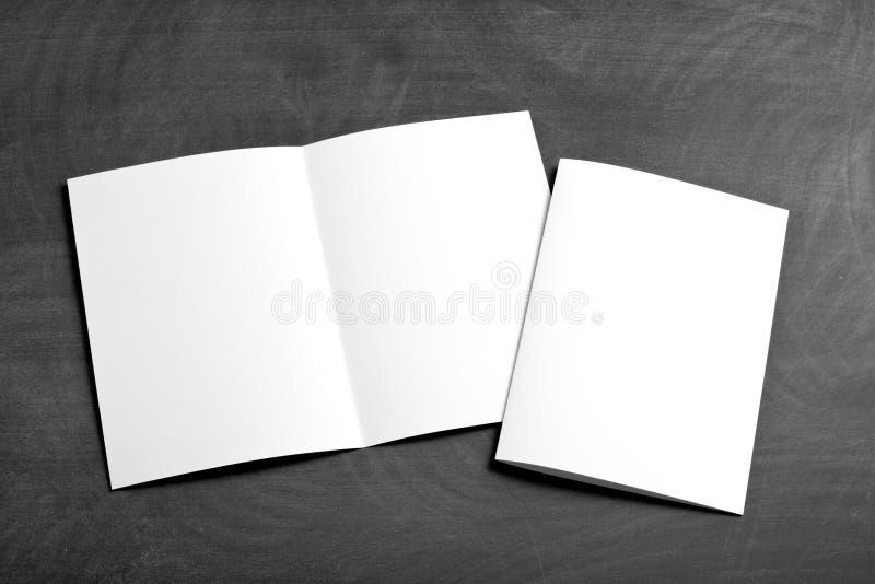 Blank white folding paper flyer stock photos
