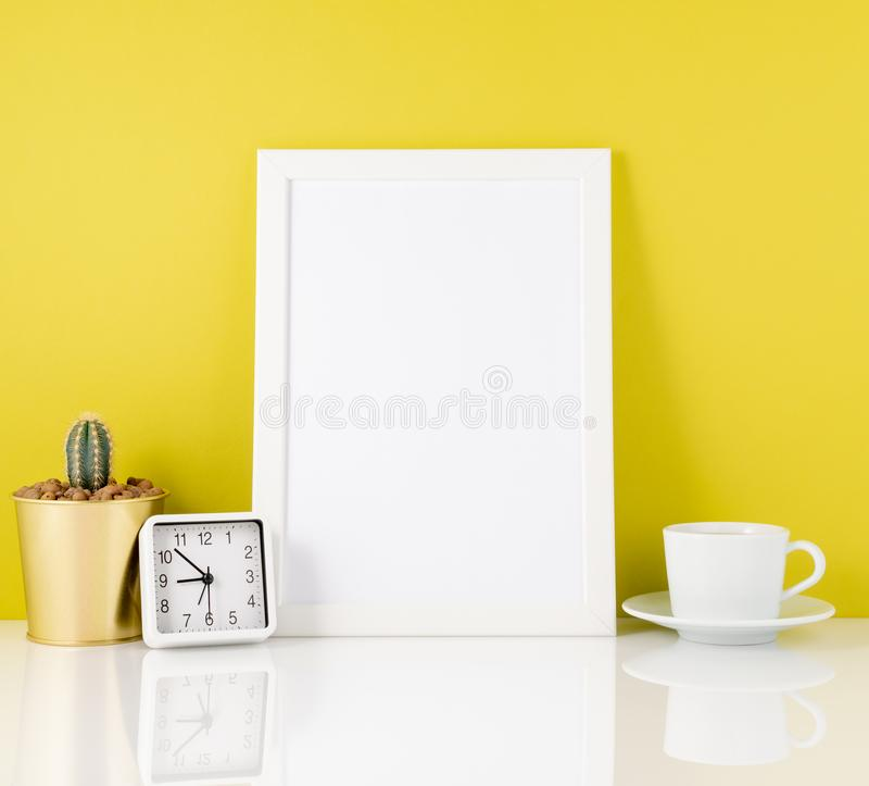 Blank white frame, clock, succulent,mug with tea or coffee again royalty free stock photo