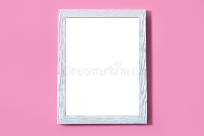 Blank white frame on pink background. Mock up stock image