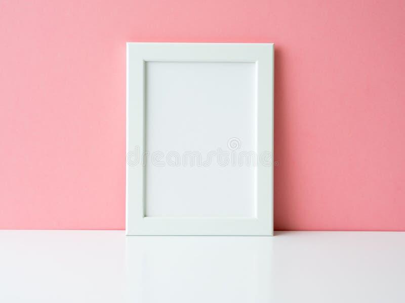 Blank white frame on a white table stock photo
