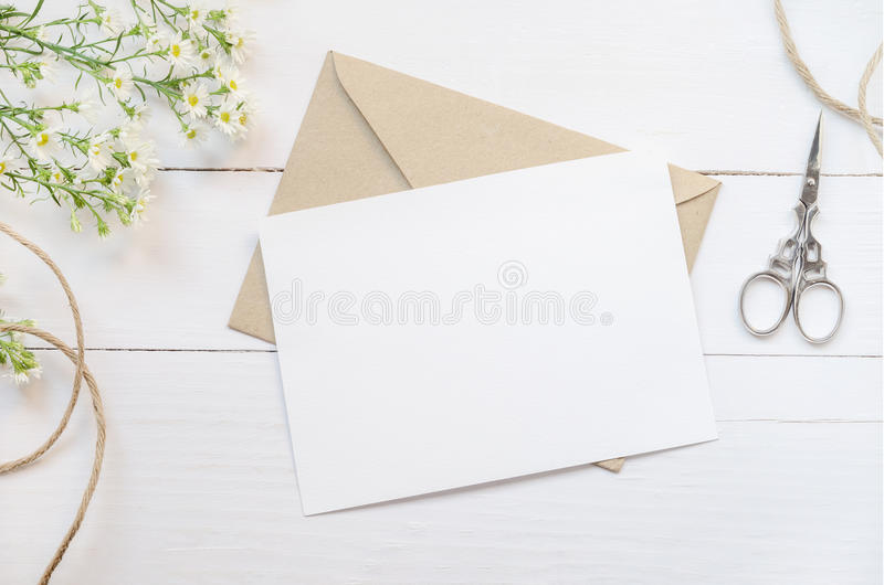 Blank white greeting card with brown envelop stock photo
