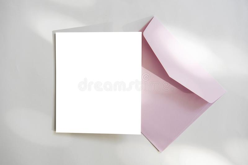 Blank white greeting card with envelope and flower. for mockup. Template stock image