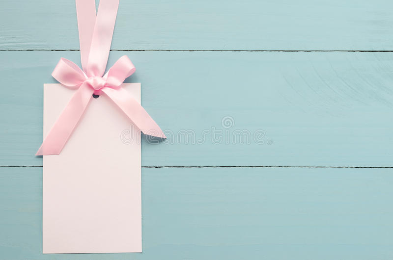 Blank white greeting card with pink ribbon stock images