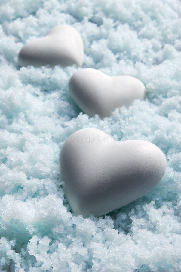 Blank White Hearts On Snow. Small DOF Stock Photos