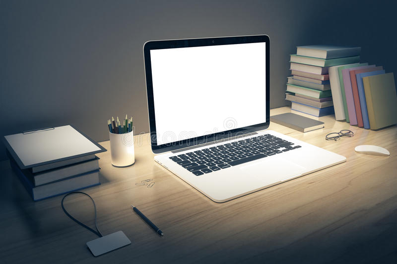 Blank white laptop screen with books and pen on wooden table, mo royalty free illustration