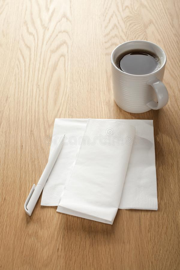 Blank White Napkin or Serviette and Pen with Coffee stock image