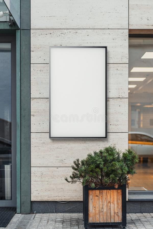 Blank white outdoor banner at bright modern building wall, 3d rendering. Blank white outdoor banner at bright modern building wall, mock up. 3d rendering royalty free stock photos