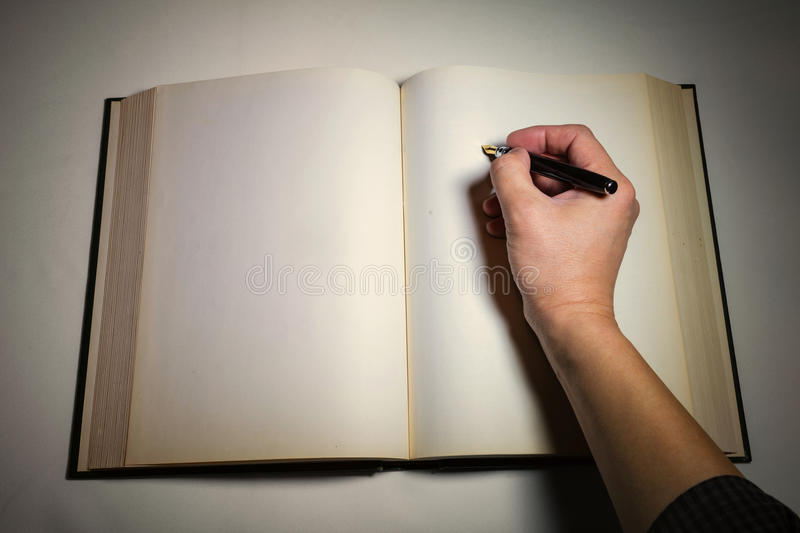 Blank white pages in an open book. Blank white pages in an open hardcover book royalty free stock photo