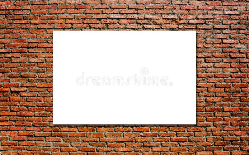 Blank white paper board at grunge brick red wall texture background royalty free stock photo