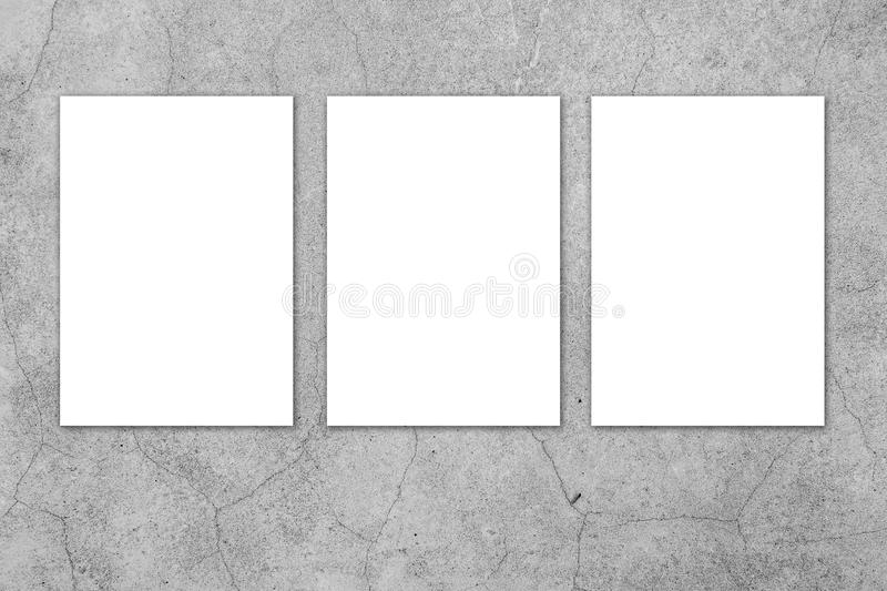 Blank white paper board at grunge cement wall texture background stock images