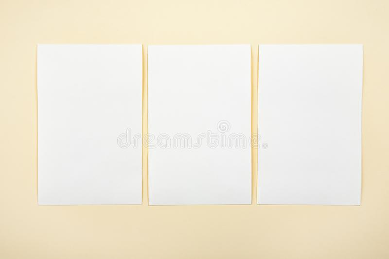 Blank white paper cards on a soft color background, business cards mockup.  stock photography