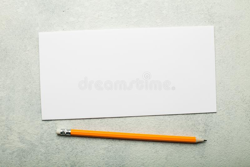 Blank white paper, DL flyer on a white vintage background stock photography