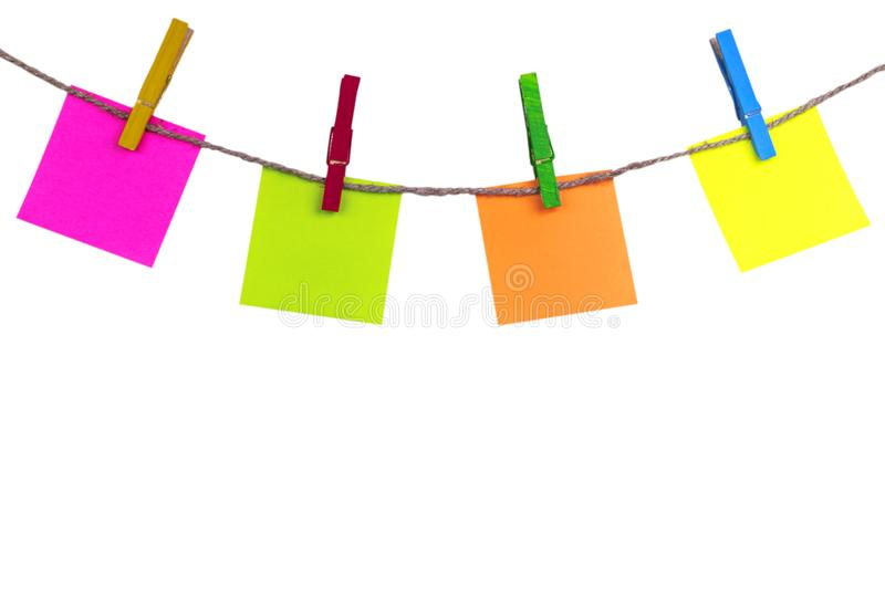 Blank white paper lists pinned with clothespins on rope isolated on white background. Blank white paper cards hanging with clothes. Pins with rope on white royalty free stock photos