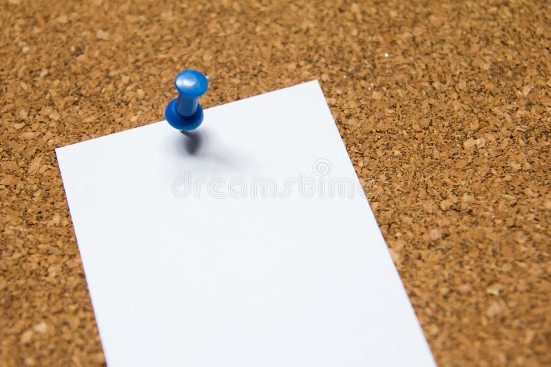 Blank white paper pin on cork board background. For remind, to do list or news bulletin royalty free stock images