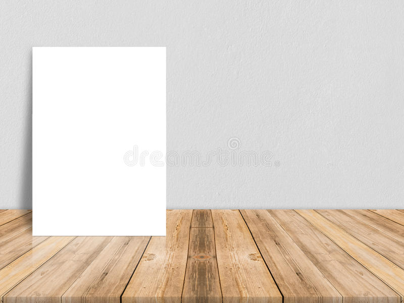 Blank white paper poster on plank wooden floor and concrete wall. Template mock up for adding your content,leave side space for display of product royalty free stock photos