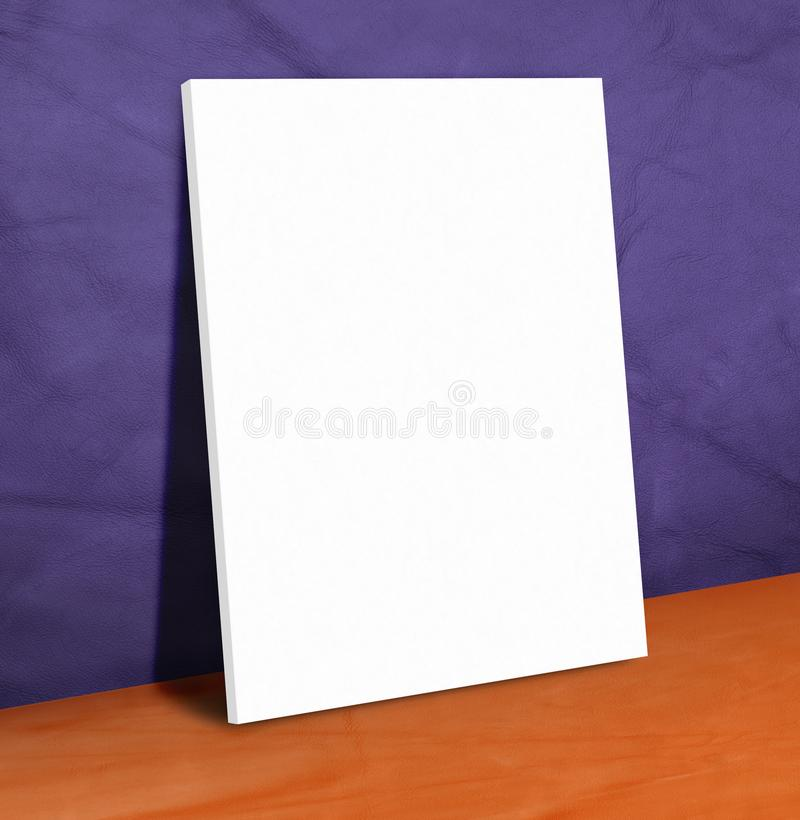 Blank white paper poster on purple leather wall and orange floor stock image