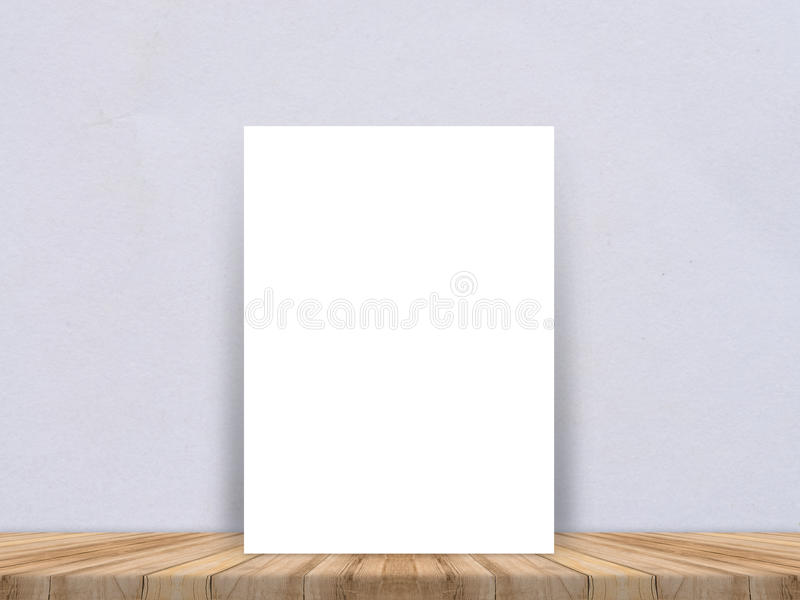 Blank white paper poster at tropical plank wooden floor and paper wall, Template mock up for adding your content,leave side space. For display of product royalty free stock photo