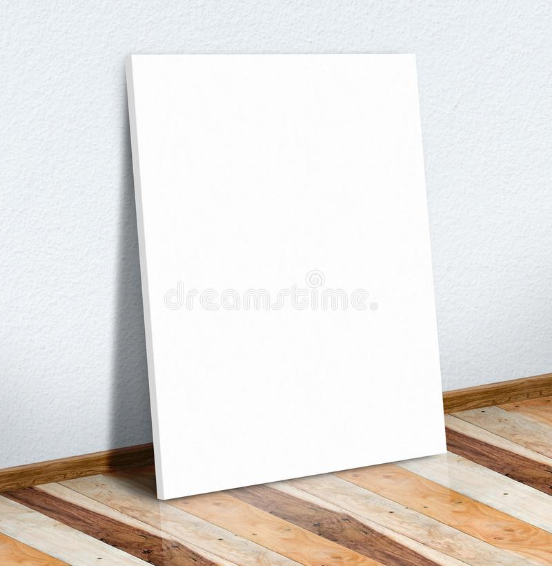 Blank white paper poster on white wall and wooden floor,Mock up. To display or montage of your content stock photography