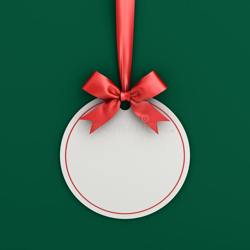 Blank white paper round christmas ball frame tag label card template hanging with shiny red ribbon and bow. Isolated on green background with shadow for stock photos
