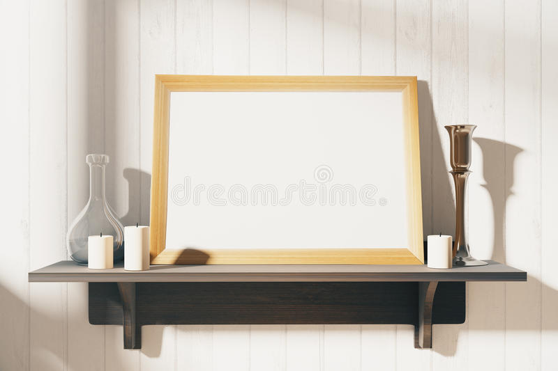 Blank white picture frame with candlesticks on brown wooden shelf, mock up stock image
