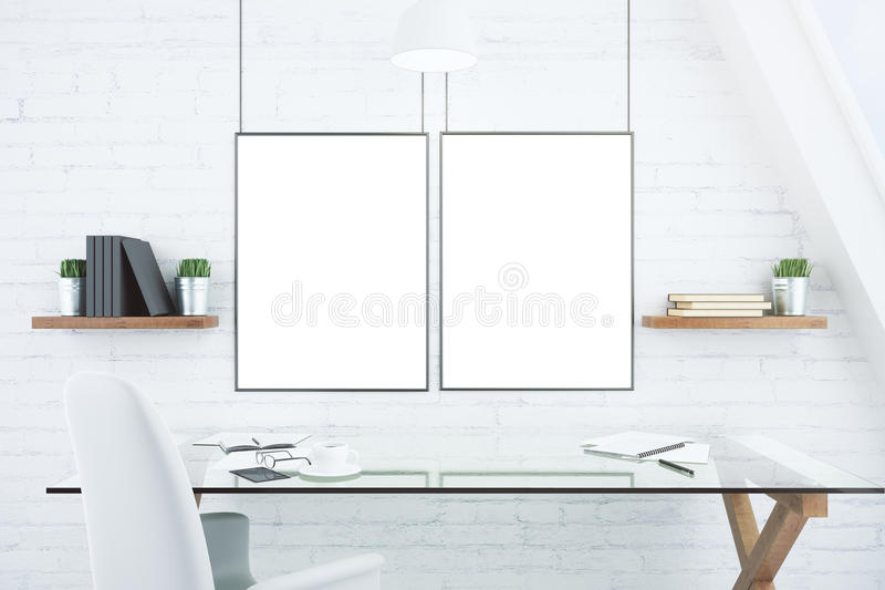 Blank white picture frames on brick wall in modern office with g stock image
